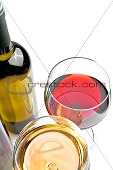 top of view of red and white wine glasses near wine bottle