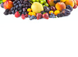Border of different fruits isolated on white