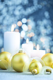 Christmas light blue background  with candles and baubles