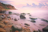Colorful Sunset over the Sea and Rocky Coast