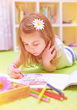 Preschooler girl painting with colorful pencil