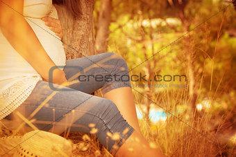 Pregnant female in autumnal park