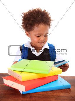 Little black boy reading books