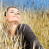 Woman enjoying on the wheat field