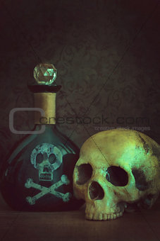 Skull with poison bottle