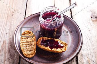 black currant jam in glass jar