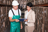 Warehouse worker and manager using tablet pc