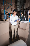 Warehouse manager using her tablet pc