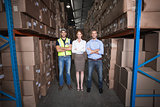 Warehouse team smiling at camera