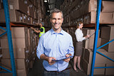 Warehouse manager smiling at camera