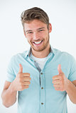 Happy young man gesturing thumbs up