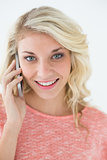 Beautiful young woman using mobile phone