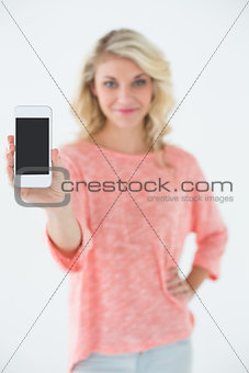 Beautiful woman showing you mobile phone