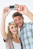 Attractive young couple taking a selfie together