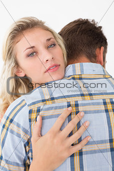 Close up of young couple embracing