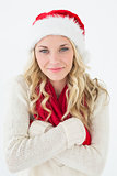Attractive young woman wearing santa hat