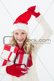 Attractive woman wearing santa hat with gifts