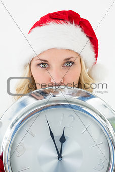 Attractive santa woman holding cropped clock