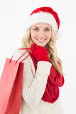 Attractive santa woman with shopping bag