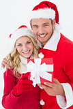 Attractive young couple wearing santa hats with gift