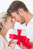 Attractive young couple holding gift