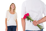 Man hiding bouquet of roses from woman