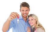 Happy attractive young couple holding new house key