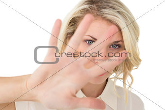 Portrait of young woman signals stop