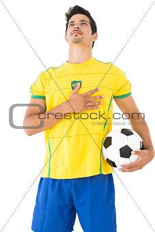 Brazilian football player listening to anthem