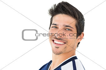 Portrait of smiling handsome football player