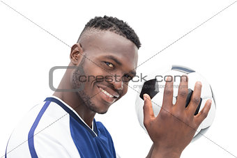 Close up portrait of a smiling handsome football player