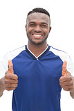 Portrait of a football player gesturing thumbs up
