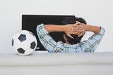 Soccer fan watching tv