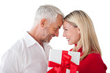 Happy mature couple holding gift