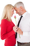 Romantic mature couple holding rose