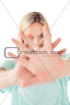 Portrait of mature woman signals stop