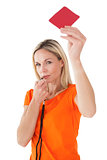 Mature woman blowing whistle and holding red card