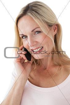 Beautiful mature woman using mobile phone