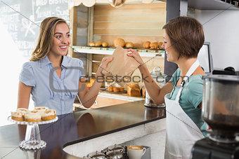 Barista serving a happy customer