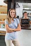 Pretty waitress and customer smiling at camera