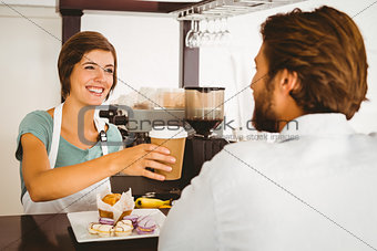 Pretty waitress serving happy customer