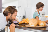 Handsome customer eyeing up plate of croissants