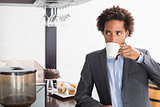 Happy businessman having a coffee