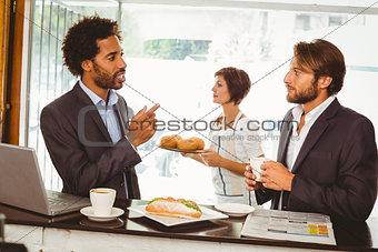 Businessmen enjoying their lunch hour