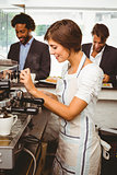 Pretty barista making cup of coffee