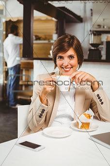 Pretty businesswoman working on her break