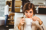 Pretty businesswoman enjoying her coffee