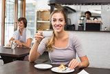Pretty blonde enjoying cake and coffee