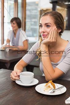 Pretty blonde enjoying cake and coffee