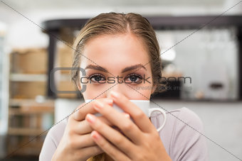 Pretty blonde enjoying a coffee